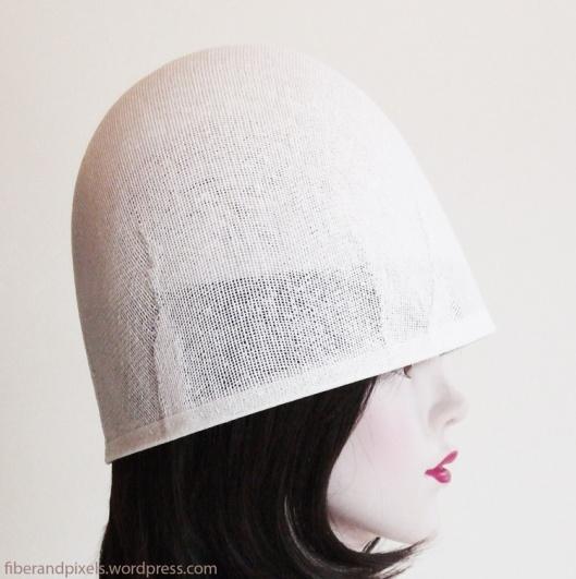 inner and outer buckram shapes together, inner shape holds helmet up